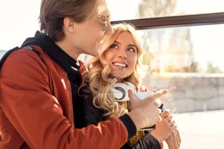 smiling couple in public transport