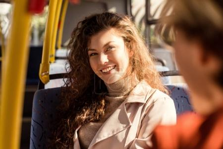 smiling woman in city bus