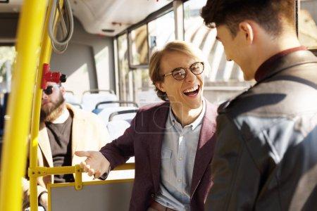 friends having conversation in public transport
