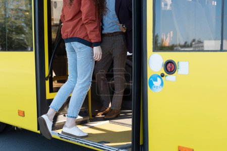 Photo for Cropped shot of woman in casual clothing entering city bus - Royalty Free Image