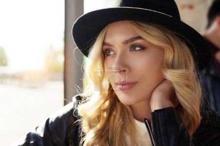 Photo for Portrait of beautiful thoughtful woman in black hat looking away - Royalty Free Image