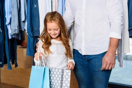 daughter with shopping bags