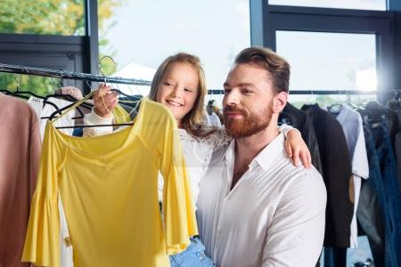 father and daughter shopping in boutique