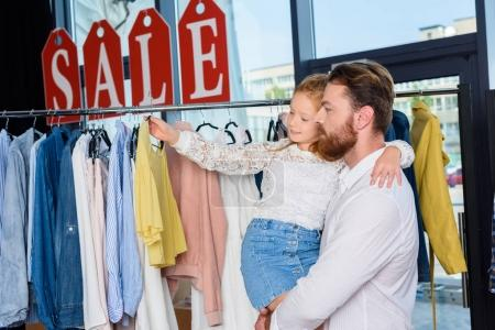 father and daughter in boutique