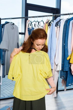 Photo for Attractive woman shopping in stylish boutique - Royalty Free Image