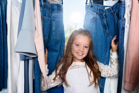 child posing in boutique