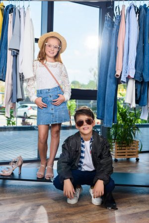 little stylish couple in boutique