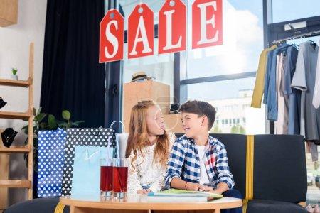 siblings having fun in boutique