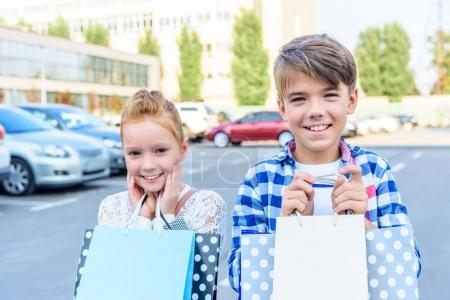 sister and brother with shopping bags