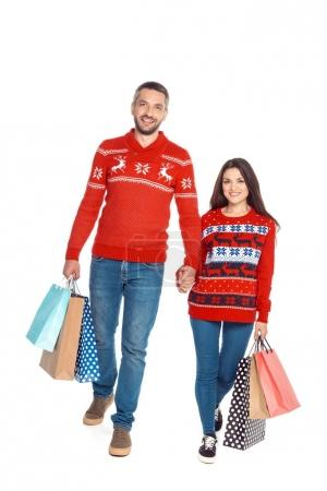 couple holding hands at christmastime