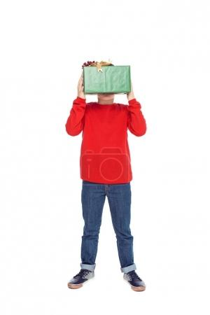 Photo for Little boy in red sweater holding christmas present, isolated on white - Royalty Free Image
