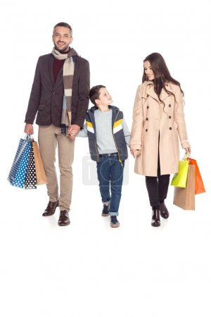 parents and son with shopping bags