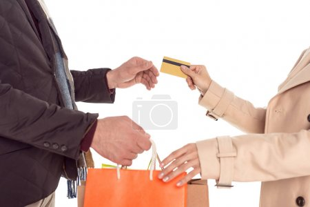 couple with shopping bags and credit card