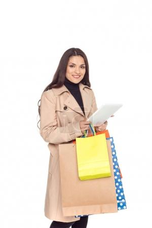 woman with tablet and shopping bags