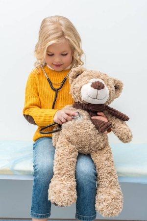 girl listening to teddy bear breath