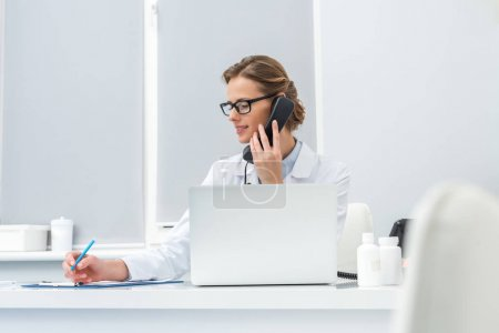 female doctor talking by phone