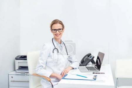 female doctor sitting at office