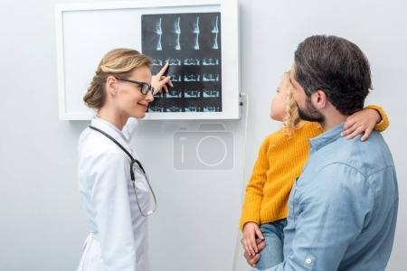 doctor showing x-ray scans to patients
