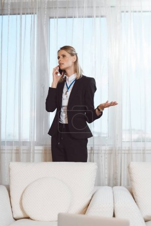 businesswoman using smartphone in hotel room