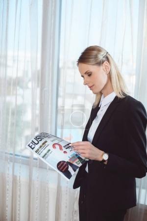 businesswoman reading magazine