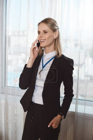 businesswoman using smartphone in hotel room