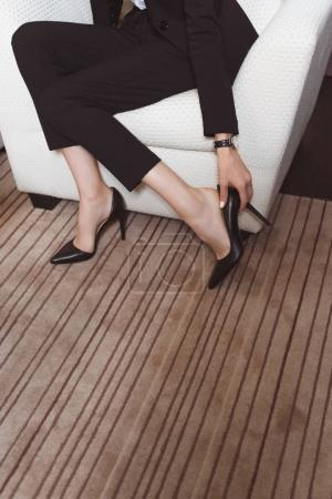 businesswoman with high heeled shoes in hotel room