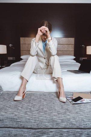 overworked businesswoman in hotel room