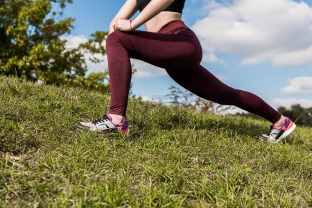 Photo for Cropped shot of woman stretching legs outdoors before workout - Royalty Free Image