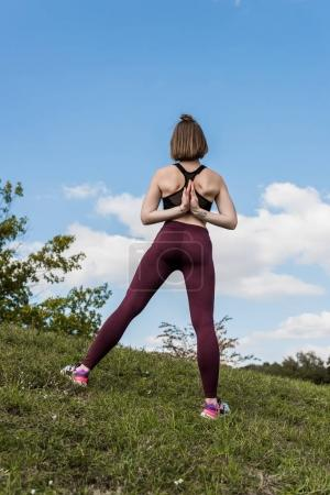 Woman in Reverse Prayer Pose