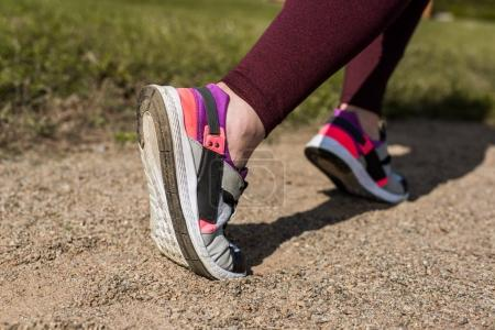 Photo for Cropped shot of woman jogging in modern sneakers - Royalty Free Image