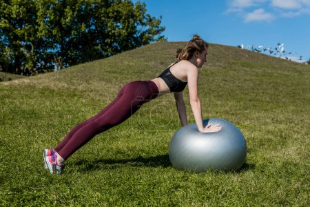 woman working out with fitball