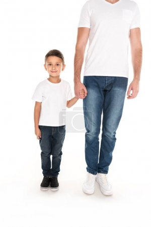 little boy and father holding hands