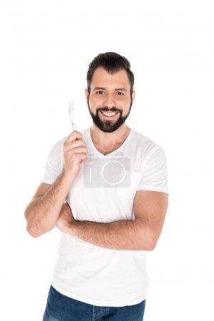 Smiling man with toothbrush