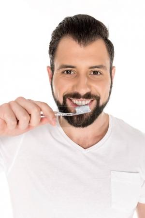 smiling man with toothbrush
