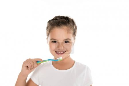 Photo for Portrait of little smiling girl holding toothbrush isolated on white - Royalty Free Image
