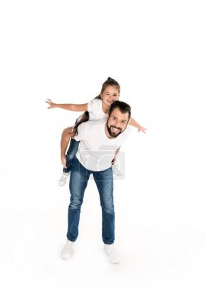 father and daughter piggybacking together
