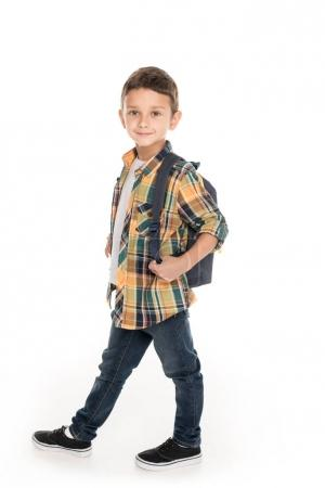 boy with backpack going to school
