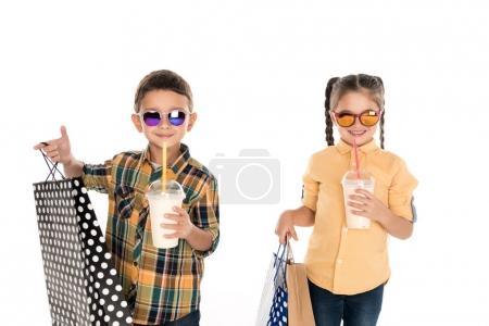 siblings with shopping bags and milkshakes