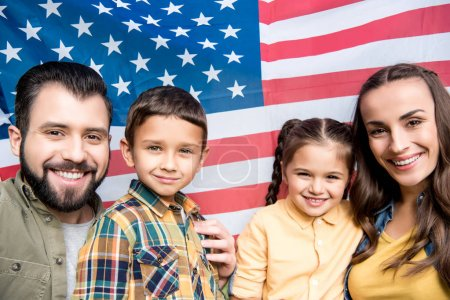 Photo for Happy family with children holding american flag - Royalty Free Image