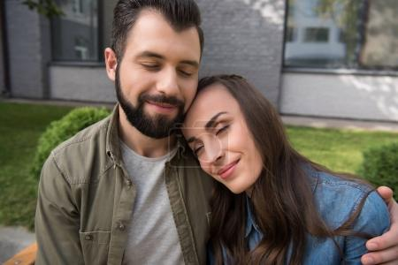 couple hugging with closed eyes