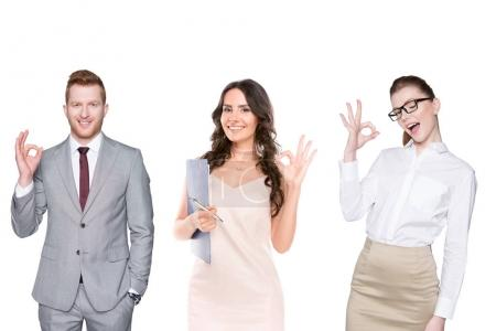 Photo for Portrait of young smiling people showing ok sign isolated on white - Royalty Free Image
