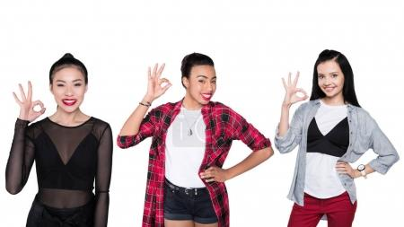 Photo for Portrait of young multiethnic women showing ok sign isolated on white - Royalty Free Image