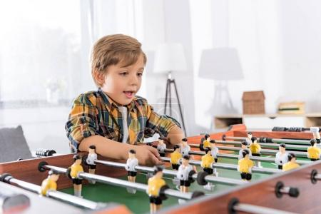 boy playing table football