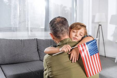 American father and son embracing