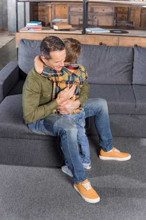 father embracing with son