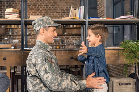 happy boy and father in military uniform