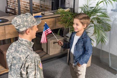 military father and son with usa flag