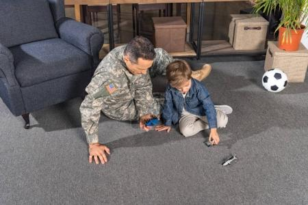 military father and son playing with toys