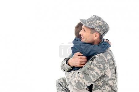 father in military uniform embracing with son
