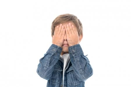 Photo for Obscured view of little boy covering eyes with hands isolated on white - Royalty Free Image